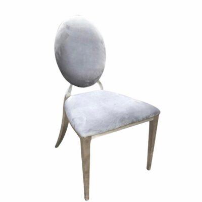 Pelēks samta krēsls